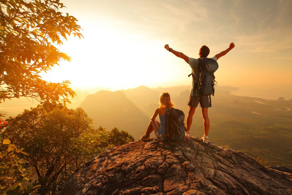 bigstock Two hikers enjoying sunrise fr 47984279 966x644 - Траты туристов в Крыму